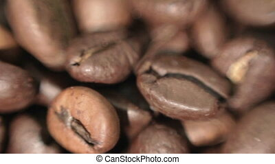 Roasted coffee beans. Soft focus.
