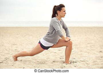 Fitness Woman on the Beach Training
