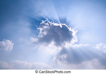 sun rays behind the cloud,beautiful blue sky
