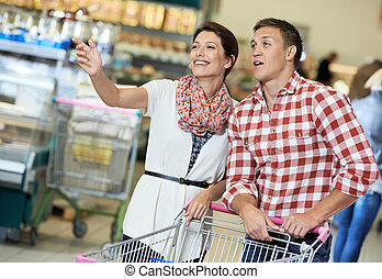 Family at food shopping in supermarket - Family couple with...
