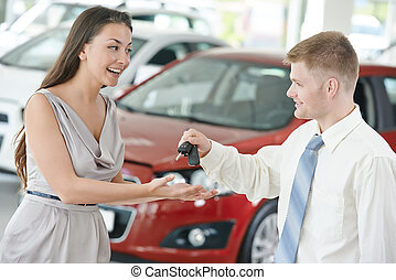 Car selling or auto buying - salesperson demonstrating new...