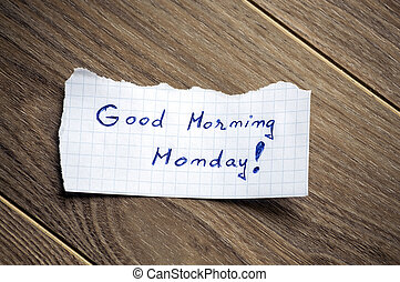 Good Morning Monday written on piece of paper, on a wood...