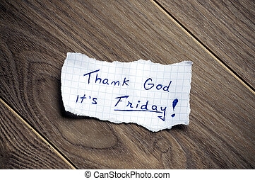 Thank God it's Friday! - Friday message written on piece of...