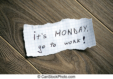 It's monday, go to work. - Monday message written on piece...