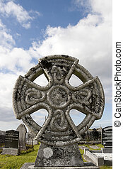 ancient celtic cross against in Irish cemetary - an ancient...