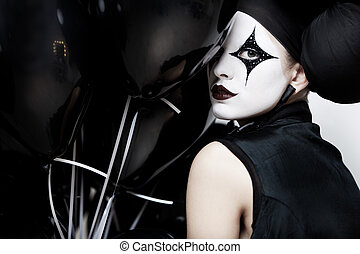 Mime stylized fashion close-up partrait of a young beautiful...