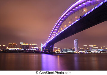 night view of modern bridge - night view of a modern highway...