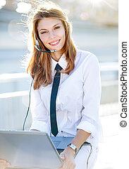 Lively Call Center Operator Girl - smiling brunette girl in...