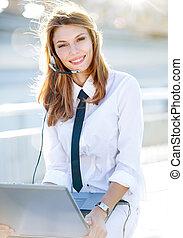 Lively Call Center Operator Girl - smiling brunette girl in...
