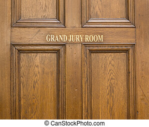 Old oak entrance door ot Grand Jury Room in Crown Court