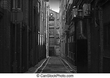 Looking down a long dark back alley