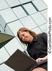 Business Woman Working on Laptop - A Young Business Woman...