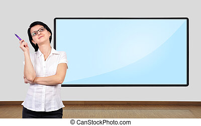 businesswoman thinking and big plasma on wall