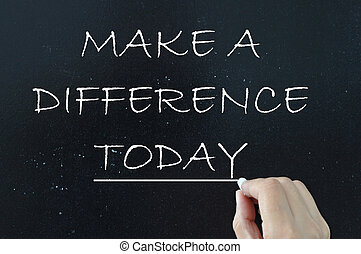 Make a difference - Motivational phrase handwritten on a...