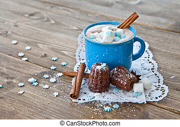Hot chocolate with little cakes for christmas