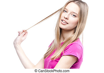 young beautiful woman touches her hair