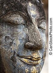 Buddha head detail - Head detail of old Buddha statue in the...