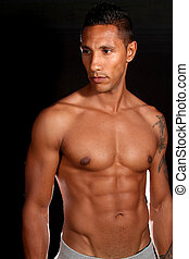 Muscular male fitness model - Muscular man photographed in...