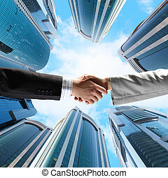 Business handshake - Close up image of hand shake against...