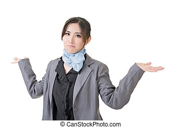 Young asian businesswoman shrugging - Close-up portrait of...
