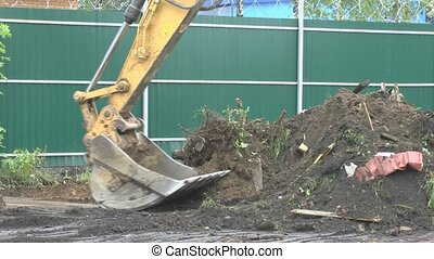 Excavator is digging the ground