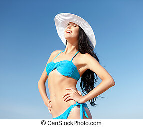 girl in bikini standing on the beach - summer holidays and...
