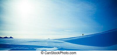 climbing a mountain. alpinists climbing a mountain