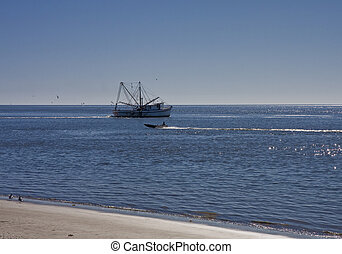 Shrimp Boat and Motor Boat - A shrimp boat working the calm...
