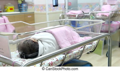 newborn baby in nursery
