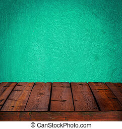 Background with wooden table and grunge cyan wall