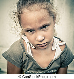 Portrait of sad child - portrait of a sad girl on a...