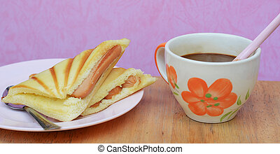 cup with bread Sausage in morning