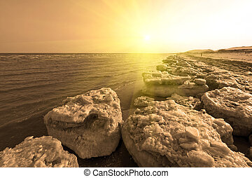 coast residual ice natural scenery - frozen sandy beach...