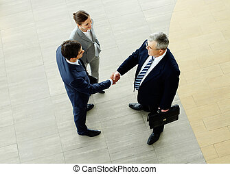 Business agreement - Two businessmen shaking hands...