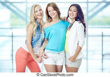 Stylish girls - Portrait of three happy girls in smart...