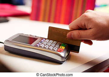 Paying by card - Close-up of payment through machine by...