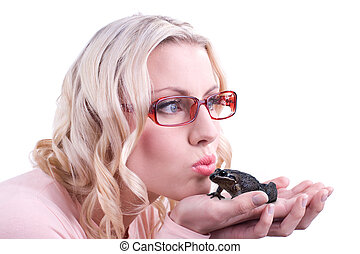 Kissing a frog - An attractive blonde female looks away as...
