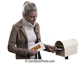 Delivering promotional flyers - An attractive young blonde...