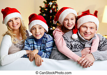 X-mas hugs - Happy parents and children sharing Christmas...