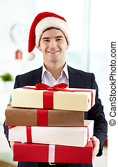 Merry Christmas! - Image of happy businessman in Santa cap...