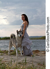 Young woman with alaskan malamute dog