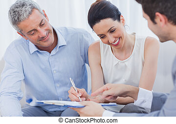 Smiling woman sign on a contract with her partnership on...