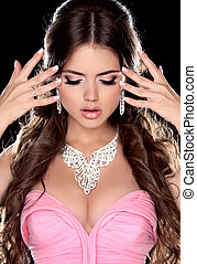 Beauty portrait of brunette sexy woman with jewelry in pink...