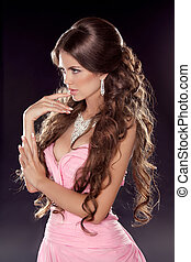Hairstyle. Long wavy hair. Fashion photo of young woman....