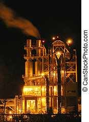 industrial processes tower heavily illuminated - Night view...