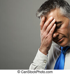 Stressed businessman - Portrait of a stressed middle age...