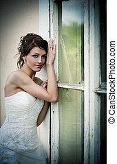 Lovely bride - Lovely and happy brunette bride posing...