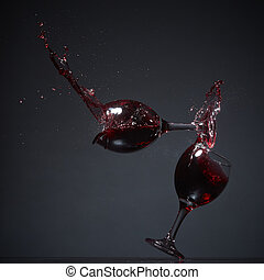 Falling wine - Two wine glasses falling on a table and...