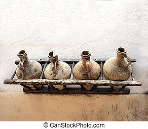 Pitchers on stucco wall - Ancient pitchers on stucco wall