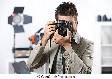 Photographer - Young man taking photo with professional...